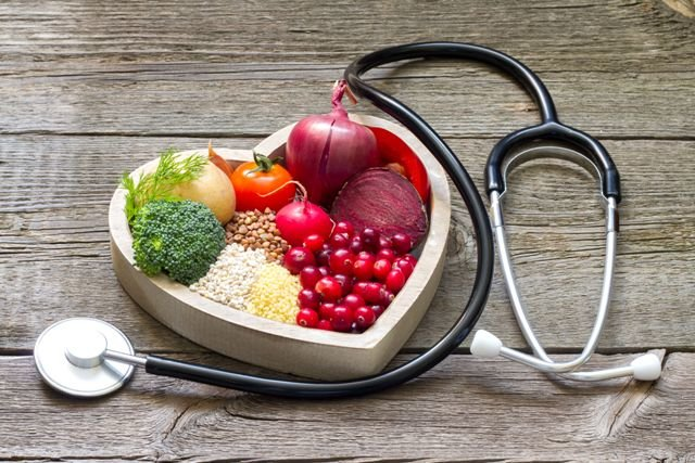 48093828 - healthy food in heart and cholesterol diet concept on vintage boards
